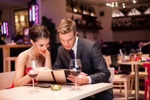 bigstock-Smiling-couple-reading-menu-a-39909421